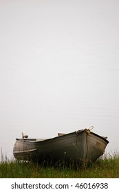 Boat on grassy shore of lake