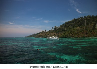 boat on the green sea with scuba diving