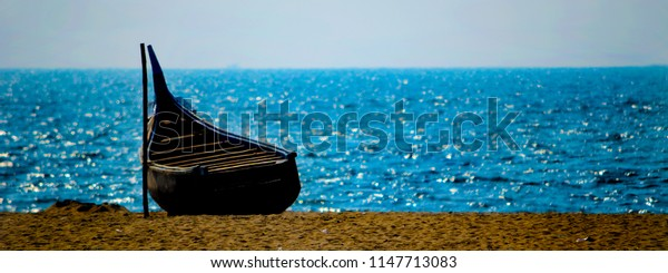 Boat on the horizon in afternoon