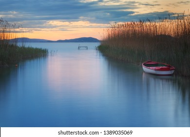 Boat on lake Balaton in the late evening with beautiful cloudy sky