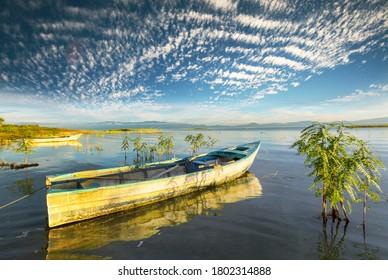 Boat on lake at beautiful sunrise