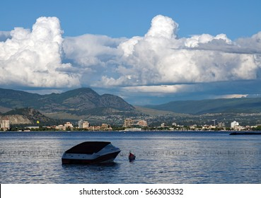 Boat on Lake with Clouds