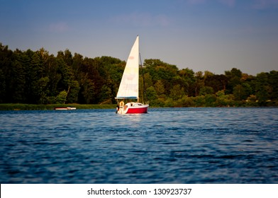 boat on lake with green trees
