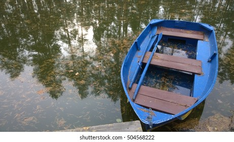 Boat on the lake with reflection of trees