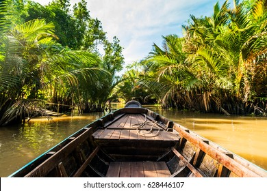 Boat on the Mekong River, swim through the canals in the Mekong Delta in Asia