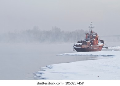 Boat on the misty river Angara in the winter, Siberia, Russia