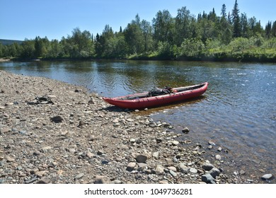 Boat on the pebbly shore of the North river. Tourism in a national Park in the Northern Urals in Russia