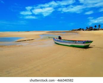 Boat on the sandy Galinhos beach in Brazil