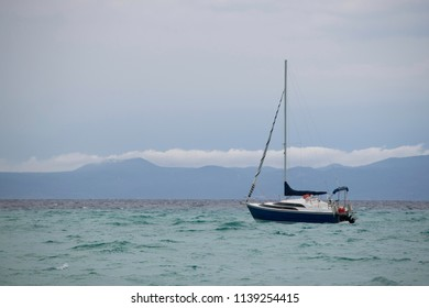 boat on the sea, cloudy day wind and rain
