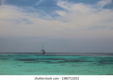 boat on the sea with  horizon