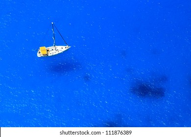 Boat on sea - top view with a lot of blue copy space