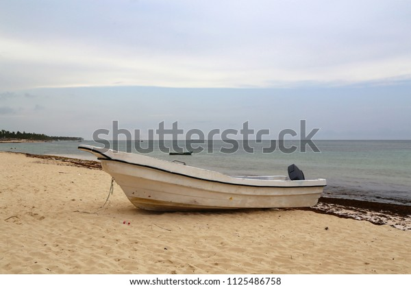 Boat on the shore of the ocean