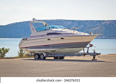 Boat on a trailer by the sea, Pag island