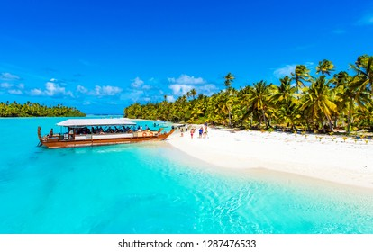 Boat on a tranquil sandy beach in Aitutaki island, Cook Islands, South Pacific. Copy space for text