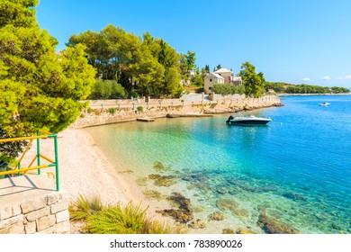 Boat on turquoise sea water of beach in Sumartin town on Brac island, Croatia