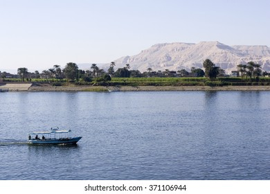 Boat on the water with shore in the background