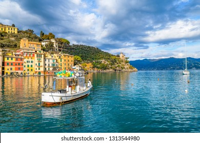 Boat on the water in the spectacular harbor of Portofino, Liguria, Italy