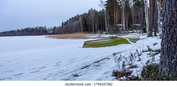 Boat on the winter lake, Finnland.