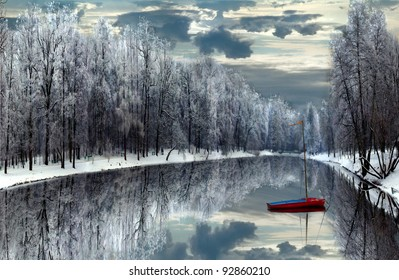 boat on winter lake/winter memories/boat on lake at City Park Lodz,Poland