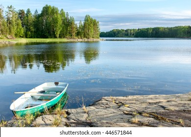 Boat with paddles parked in a bay of Pien-Kosa island in Ladoga freshwater lake, Republic of Karelia, Russia
