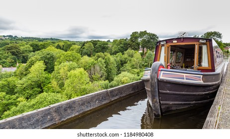A boat passing the Pontcysyllte Aqueduct (the highest in the world) near Llangollen in Wales, UK