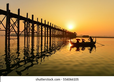 Boat and people on U-Bein bridge, Mandalay Myanmar
