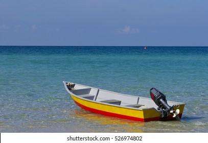 Boat at Perhentian Kecil Island beach, Terengganu, Malaysia.