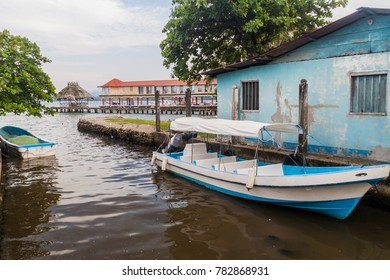 Boat and a pier in Livingston village, Guatemala