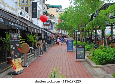 Boat quay singapore - September 4,2017 : The tourist walking on the Boat quay Street. It is Many Riverside restaurants at Singapore