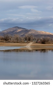 Boat Ramp at Lon Hagler Reservoir Loveland Colorado on a winters day with the foothills in the background