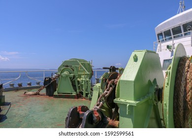 Boat reels on ferry from Bali to Lombok in Indonesia. Electrically powered mechanisms for lowering the anchor and winding the mooring ropes. Strong chains and marine ropes to anchor the ship to pier.