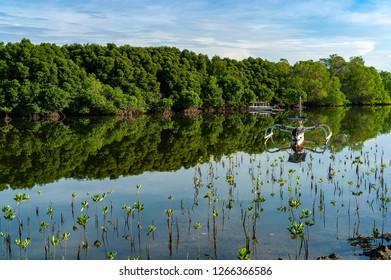 Boat and reflection with blue sky in serangan islan, Bali