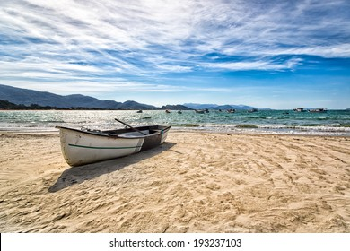 Boat resting in a nice beach in Florianopolis, Santa Catarina, Brazil. One of the main tourists destination in south region.