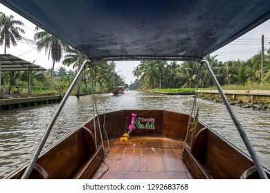 Boat ride in Damnoen saduak floating market taken in Thailand. January 16th 2019