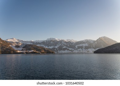 Boat ride on Lake Luzern in Switzerland in Winter with a great panorama of the Swiss Alps and sea gulls flying around the ship