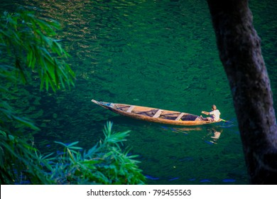 A boat rowing in the clear waters of Dawki river in Meghalaya.