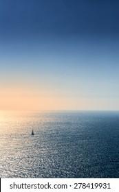 Boat sailing in the blue Aegean sea
