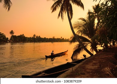 Boat sailing in kerala backwaters during sunset.