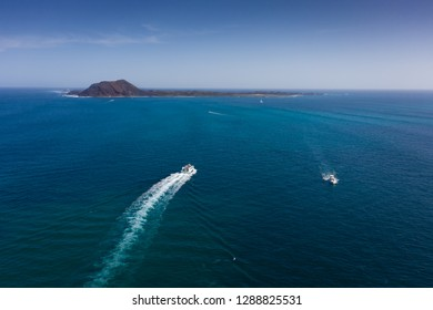 A boat sailing out towards Lobos Island from Fuerteventura, Spain