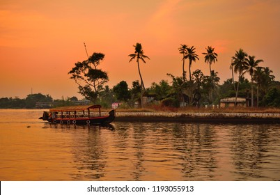 A boat sailing over alleppey backwaters at Punnamada finishing point.
