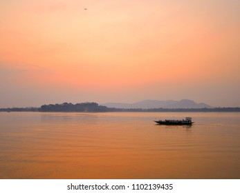 Boat sailing over river Brahmaputra during sunset.