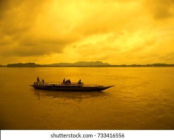 Boat sailing over river Brahmaputra during storm.