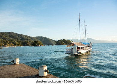 Boat sailing from the pier in the village of Abraao with passengers leaving the city of Angra dos Reis, Ilha Grande in the south of the state of Rio de Janeiro, Brazil - Shutterstock ID 1666375696