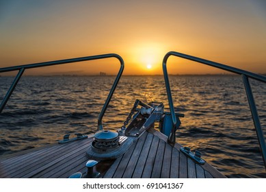 Boat sailing to sunset