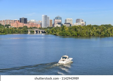 A boat sails toward Rosslyn in Potomac River - Washington DC United States of America