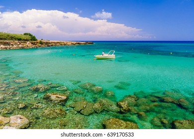 Boat in sea bay with turquoise water near Protaras, Cyprus island