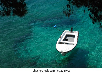 A boat at sea. A boat moored to the shore floating on the emerald green waves of color