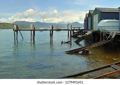 Boat sheds, ramps and jetty at Waikawa Bay in the Marlborough Sounds, Picton, New Zealand