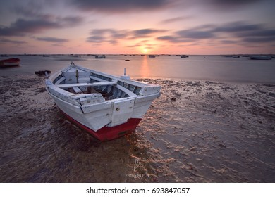 A boat at the shore waiting for the fishermen