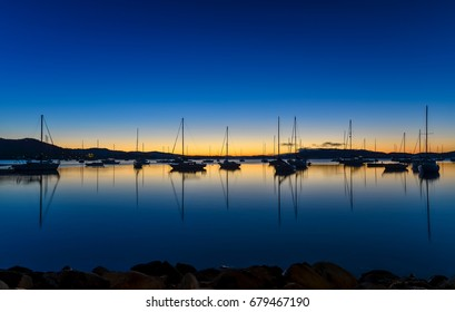 Boat Silhouettes on the Bay at Sunrise  Seen at Koolewong Foreshore, Koolewong, Central Coast, NSW, Australia